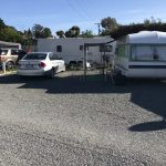 Caravans parked at Leithfield Beach Holiday Park in North Canterbury